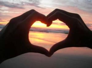hands-heart-sunset